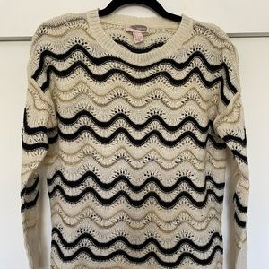 White black and gold sweater
